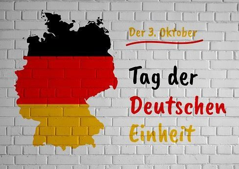 German Unity Day (Tag der Deutschen Einheit) greeting card with country silhouette and congratulatory tricolor text on the white brick wall background. Germany map country silhouette drawing template for your design.